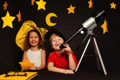 Happy five years old kids playing sky watchers Stock Photos