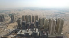 Emirates city towers. Cityscape of Ajman with modern buildings aerial Stock Footage