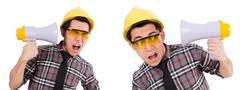 Young construction worker with loudspeaker isolated on white - stock photo