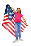 Little USA patriot proudly holding big banner - stock photo