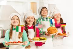 Young cooks with traditional food of their states - stock photo