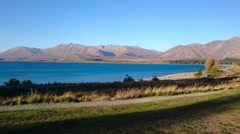 Scenic Afternoon View Lake Tekapo, NZ. Pan Left Stock Footage