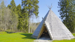 The triangular wooden house in the yard Stock Footage