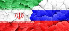 Iran flag with Russia flag on a grunge cracked wall Stock Illustration