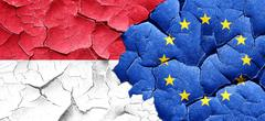 Indonesia flag with european union flag on a grunge cracked wall - stock illustration
