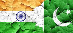 India flag with Pakistan flag on a grunge cracked wall Stock Illustration