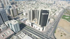 City towers. Cityscape of Ajman with modern buildings aerial top view Stock Footage