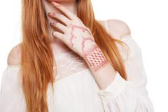Boho hippie style young redhead woman isolated - stock photo