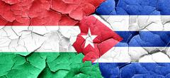 Hungary flag with cuba flag on a grunge cracked wall - stock illustration
