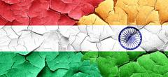 Hungary flag with India flag on a grunge cracked wall Stock Illustration