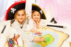 Smiling pirates drawing the map of Treasure Island Stock Photos