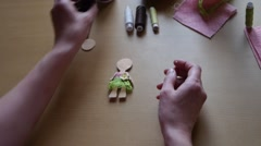 Home crafts (doll magnet for fridge) 34 - stock footage