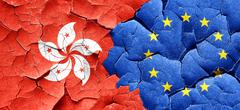 hong kong flag with european union flag on a grunge cracked wall - stock illustration