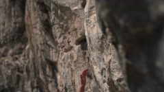 Female Climber Reaching for the High Rocks 4K Stock Footage