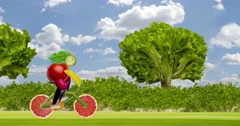 Bicycle made with fruit and vegetable. Woman, girl riding bike Stock Footage