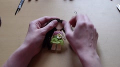 Home crafts (doll magnet for fridge) 40 - stock footage