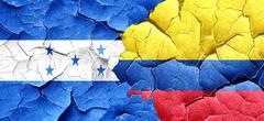 Honduras flag with Colombia flag on a grunge cracked wall - stock illustration