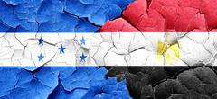 Honduras flag with egypt flag on a grunge cracked wall Piirros