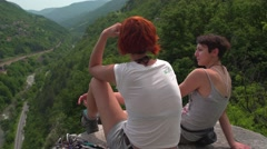 Female Climbers Enjoying the View from High Rocks Stock Footage