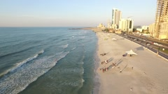 Cityscape of Ajman Coastline with beach and gulf aerial top view Stock Footage