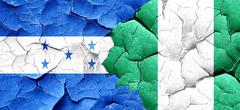 Honduras flag with Nigeria flag on a grunge cracked wall Piirros