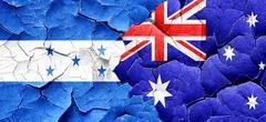 Honduras flag with Australia flag on a grunge cracked wall Stock Illustration