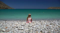 Happy little girl on the beach Stock Footage