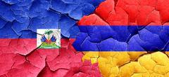 Haiti flag with Armenia flag on a grunge cracked wall Stock Illustration