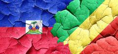 Haiti flag with congo flag on a grunge cracked wall - stock illustration