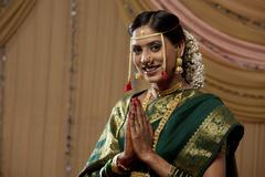 Beautiful Indian bride praying with hands clasped Stock Photos