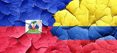 Haiti flag with Colombia flag on a grunge cracked wall - stock illustration