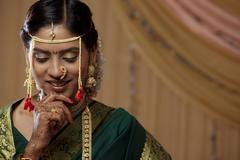 Shy young Maharashtrian bride looking down Stock Photos
