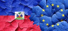 Haiti flag with european union flag on a grunge cracked wall - stock illustration