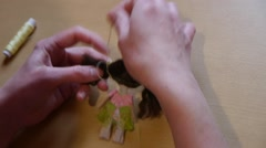 Home crafts (doll magnet for fridge) 52 Stock Footage