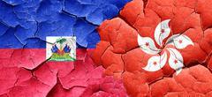 Haiti flag with Hong Kong flag on a grunge cracked wall Piirros