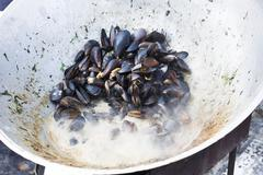 Plenty of seafood, mussels on grill pan Stock Photos