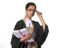 Portrait of female lawyer holding documents isolated over white background Stock Photos