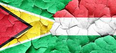 Guyana flag with Hungary flag on a grunge cracked wall Stock Illustration