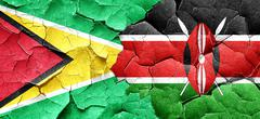 Guyana flag with Kenya flag on a grunge cracked wall - stock illustration