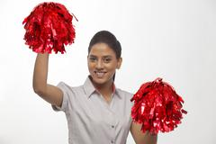 Portrait of happy cheer leader with pompoms isolated over white background Stock Photos