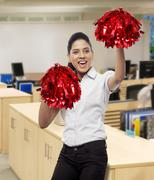 Happy cheer leader with pompoms Stock Photos