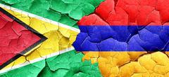 Guyana flag with Armenia flag on a grunge cracked wall - stock illustration