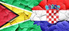 Guyana flag with Croatia flag on a grunge cracked wall Stock Illustration