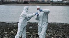 Forensic scientist taking sample at river bank Stock Footage