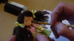 Home crafts (doll magnet for fridge) 67 - stock footage
