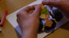 Home crafts (doll magnet for fridge) 65 Stock Footage