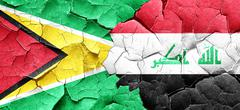 Guyana flag with Iraq flag on a grunge cracked wall - stock illustration