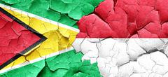 Guyana flag with Indonesia flag on a grunge cracked wall Stock Illustration