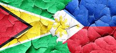 Guyana flag with Philippines flag on a grunge cracked wall Stock Illustration