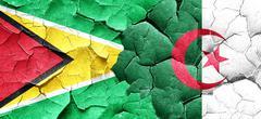 Guyana flag with Algeria flag on a grunge cracked wall Stock Illustration